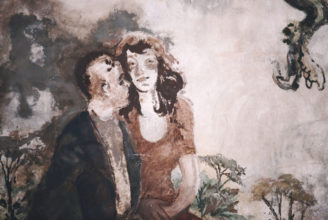 ett par, en man och en kvinna målade på en vägg.