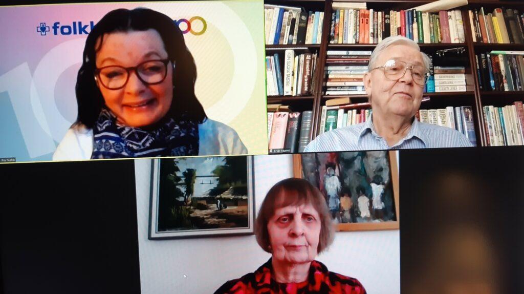 Tre personer deltar i virtuellt seminarium, deras ansikten syns i rutor på en datorskärm.